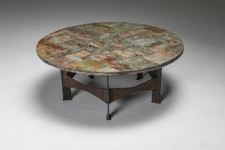 Pia Manu, coffee table, slate, iron, Belgium, 1970s.  Brutalist cocktail table by Pia Manu. The tabletop is a beautiful slate mosaic. Displaying a variety of complementary natural colors, from pink to gold and green.  This piece has a very wabi