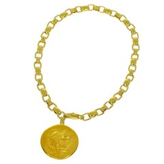 Piaget 18 and 24 Karat Yellow Gold Hans Erni Coin Pendant Bracelet