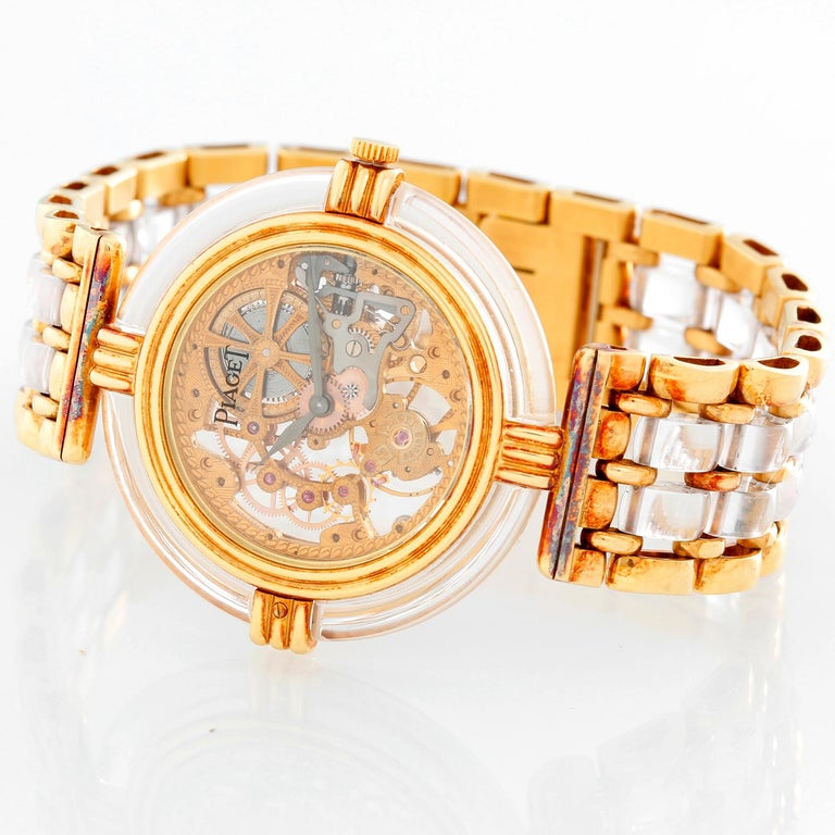 Piaget 18K  Yellow Gold Skeleton  Watch - Manual. 18K Yellow gold and rock crystal ( 32 mm ). Skeleton dial with smooth rock crystal bezel. 18K Yellow gold and rock crystal Piaget integral link bracelet and 18K yellow gold clasp. Pre-owned with