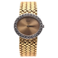 Piaget 18 Karat Yellow Gold Vintage Manual Ladies Watch with Diamond Bezel