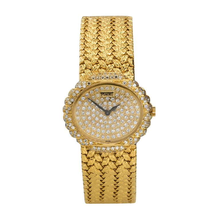Brand: Piaget Case Material: 18k Yellow Gold Case Diameter: 27mm Crystal: Sapphire Crystal Bezel: 18k Yellow Gold Diamond bezel Dial: Yellow gold Diamond pave dial Bracelet: 18k Yellow Gold bracelet Size: Will fit a 5.5