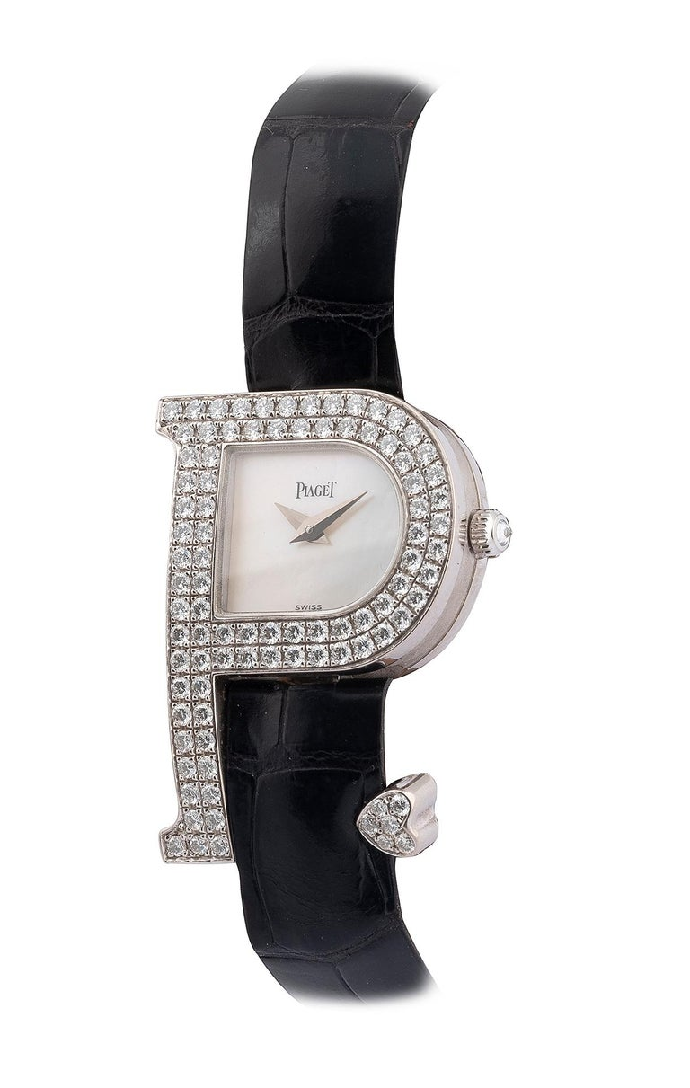 Signed PIAGET, REF. 5875, Case NO. 830272, Circa 2005 Quartz movement, mother-of-pearl dial, P-shaped case, pavé-set diamond bezel and heart detail, diamond-set crown, back secured by four screws, 18k white gold Piaget deployant clasp, case, crystal