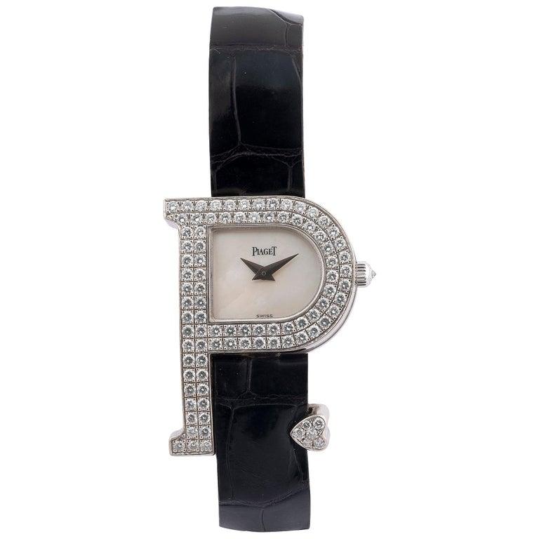 Piaget, a Ladies 18 Karat White Gold and Diamond-Set P-Shaped Wristwatch For Sale
