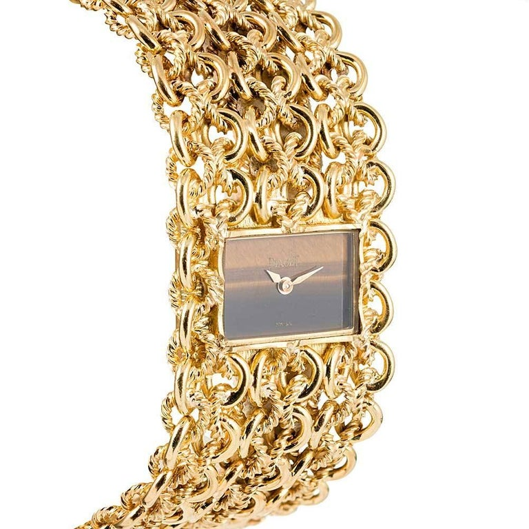 Piaget Ladies Yellow Gold Tiger's Eye Dial Bracelet Manual Wristwatch In Excellent Condition For Sale In Carmel-by-the-Sea, CA