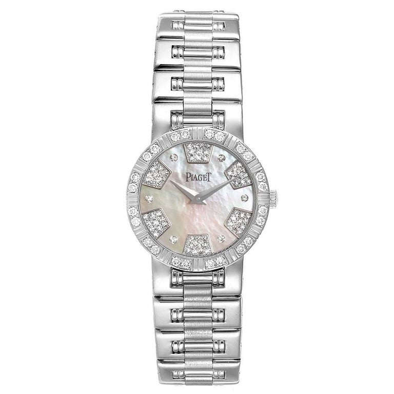 Piaget Dancer White Gold Mother of Pearl Diamond Ladies Watch 80564. Quartz movement. 18k white gold case 28.0 mm in diameter. 18k white gold diamond bezel. Scratch resistant sapphire crystal. Mother of pearl diamond dial. Brushed and polished 18k