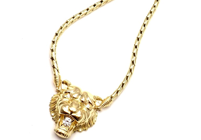 18k Yellow Gold Diamond Lion Pendant Necklace by Piaget.  With 3 round brilliant cut diamonds VS1 clarity, G color total weight approximately .45ct Details:  Length: 17