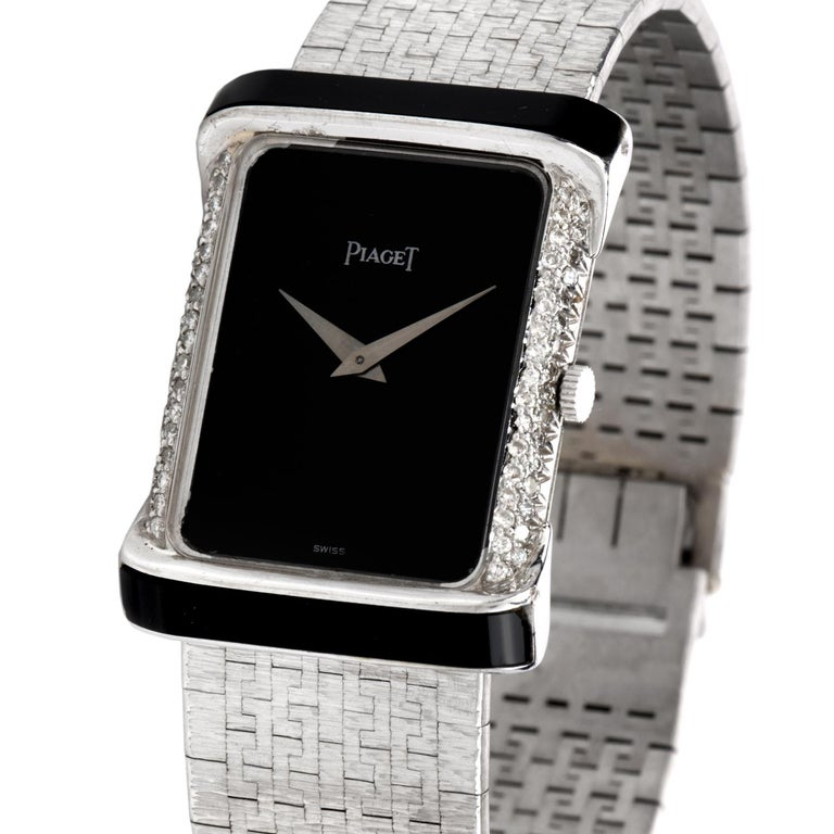 Place this elegant Early 1980'sPiaget Diamond Onyx 18K White Gold Women's Watch on your wrist daily! This fashionable and chicwatch has a rectangle onyx dial, with either side embedded with delicate pave set, round cut, genuine diamonds