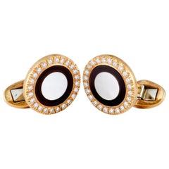 Piaget Diamond Onyx and Mother of Pearl 18 Karat Yellow Gold Round Cufflinks