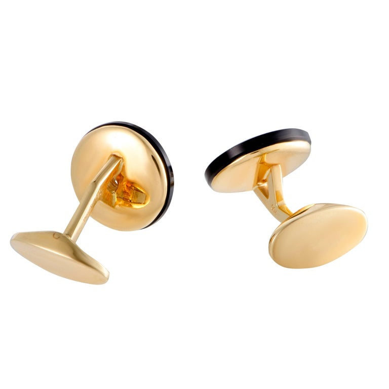 These vintage cufflinks by Piaget are chicly designed in glistening 18K yellow gold. The stunning pair of cufflinks feature 0.60ct of sparkling diamonds and glamorous onyx stones in its classy design that gives it an elegantly charming appeal.