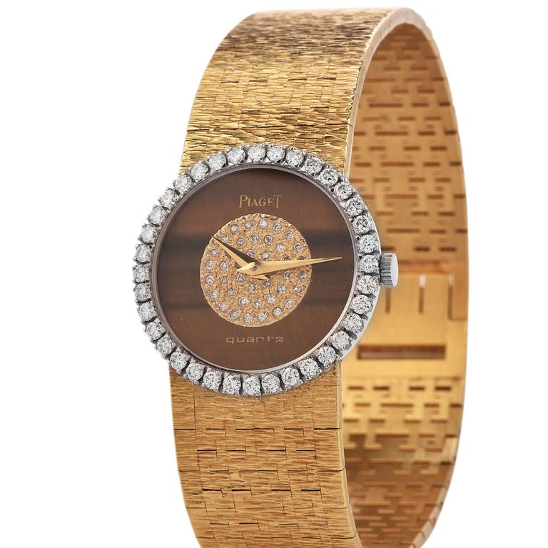 PIAGET Diamond 18k Gold Ladies Watchwith tiger eye diamond dial and diamond bezel. all original, featuring Factory set diamond in the center of the Genuine Tiger Eye dial and originaldiamond bezel. The bezel is set with 38 round brilliant cut