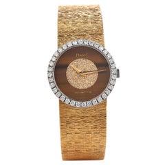 PIAGET Diamond Tiger Eye Dial Diamond Bezel 18k Gold Watch