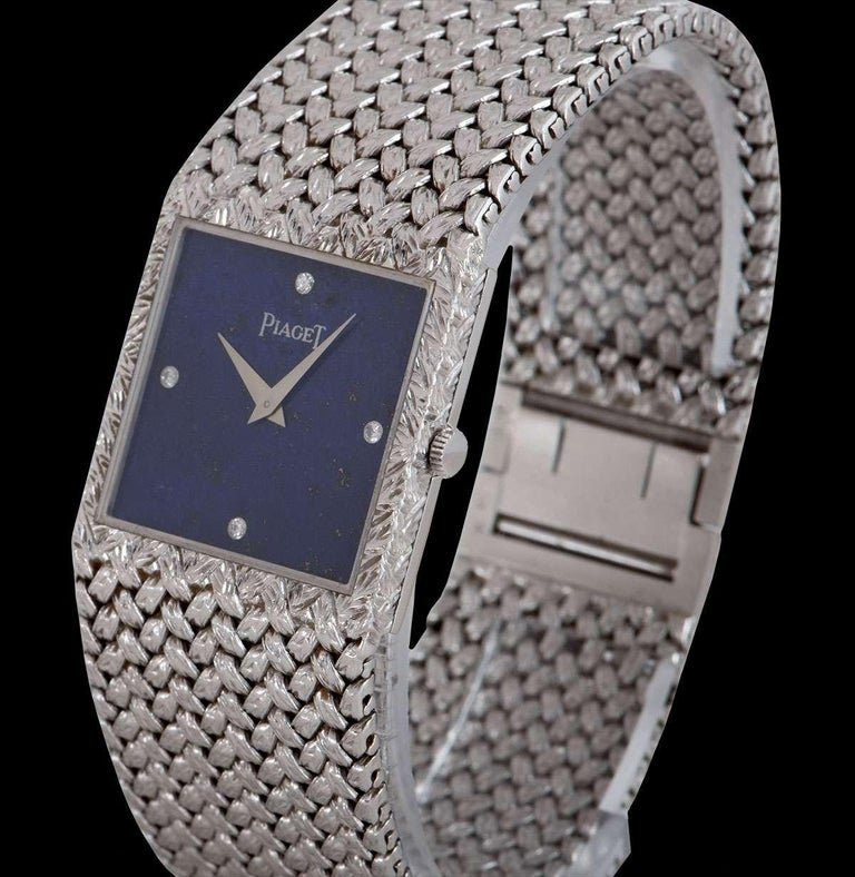 A 25 mm  18k White Gold Gents Dress Wristwatch, lapis lazuli dial set with 4 round brilliant cut diamond hour markers, a fixed 18k white gold bezel, an 18k white gold integrated bracelet with an 18k white gold jewellery style clasp, mineral glass,
