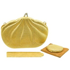 Piaget Gold and Diamond Evening Purse, a Comb and a Powder Compact