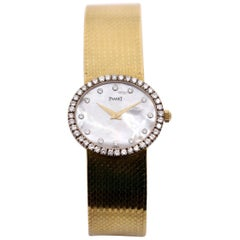 Piaget Gold Watch with Mother-of-Pearl Dial with Diamond Markers and Bezel