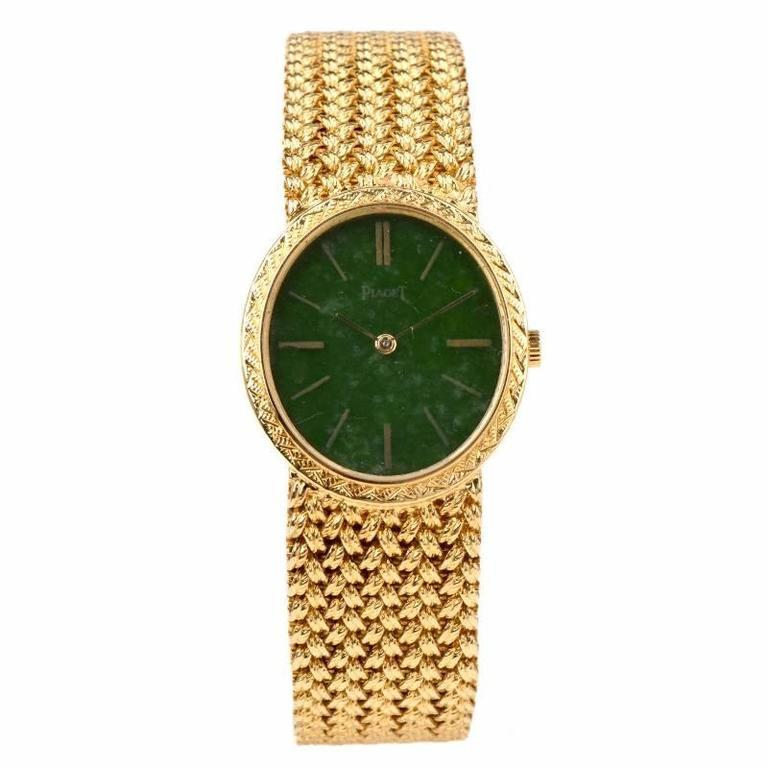 Circa 1970s Piaget 18K Yellow Gold Piaget Ladies Wrist Watch, Manual Wind movement, solid genuine jade dial with Numerals index, watch case measures 27mm by 23mm in diameter 6 7/8 inch in length. The mesh bracelet has a textured finish. Case Dial,