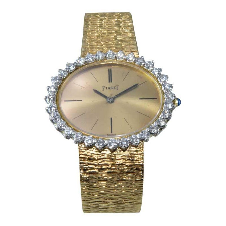 FACTORY / HOUSE: Piaget Watch Company STYLE / REFERENCE: Bracelet Dress Watch / Ref. 9801 METAL / MATERIAL:  18kt Yellow Gold CIRCA / YEAR: 1970's DIMENSIONS / SIZE: 26mm x 29mm  MOVEMENT / CALIBER: Manual Winding / 18 Jewels / 9P  DIAL / HANDS: