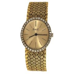 Piaget Ladies Classic Vertical Oval Yellow Gold Watch with Diamond Bezel