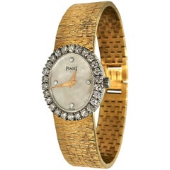 Piaget Ladies Petite Gold Watch with Mother of Pearl Diamond Dial/ Diamond Bezel