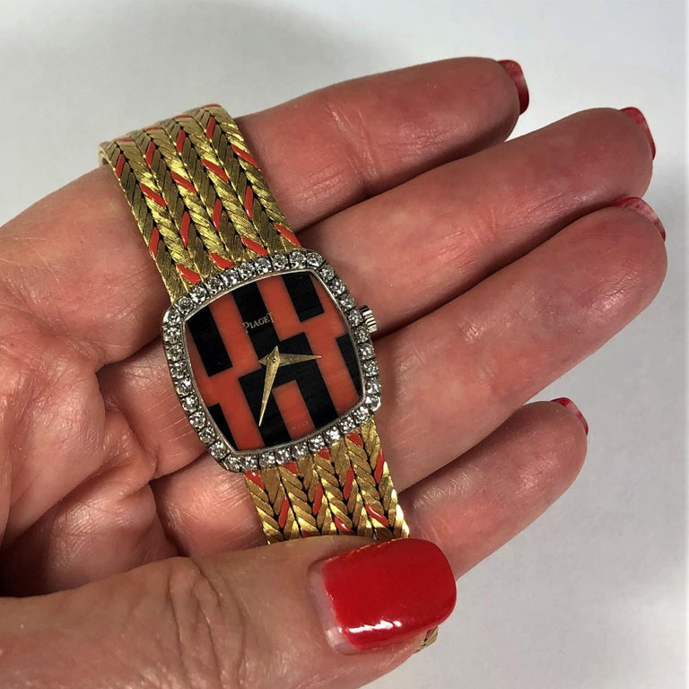 Piaget Ladies Yellow Gold Cushion Shaped Coral and Onyx Watch with Diamond Bezel In Excellent Condition For Sale In Palm Beach, FL