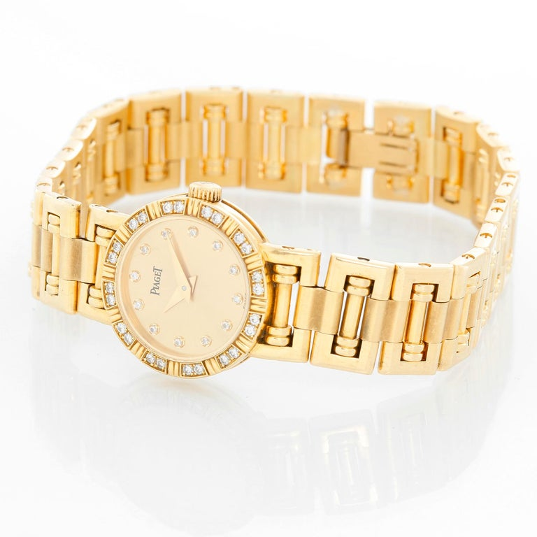 Piaget Ladies Yellow Gold Diamond Watch - Quartz. 18k yellow gold bezel with diamonds (19 mm). Champagne diamond dial. 18k yellow gold bracelet; will fit a 6 1/2 inch wrist. Pre-owned with custom box.