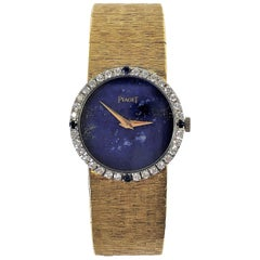 Piaget Ladies Yellow Gold Lapis Dial Watch with Diamond and Sapphire Bezel