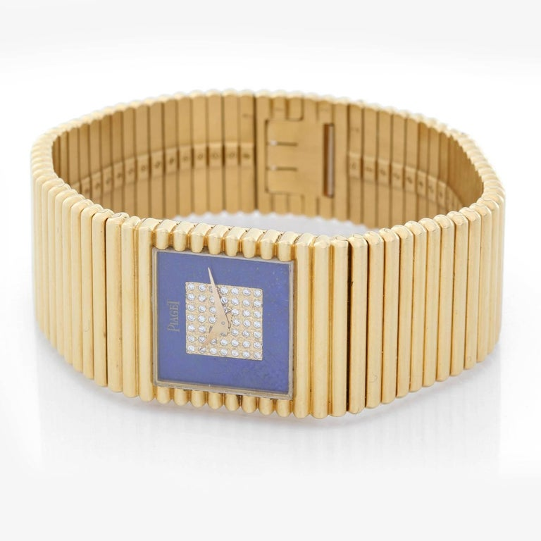 Piaget Emperador 18K Yellow Gold with Lapis Lazuli Diamond Dial Watch  - Quartz. 18K Yellow gold ( 25 mm ) . Lapis Lazuli & 53 diamonds dial . 18K Yellow gold Piaget bracelet. 6 3/5 inch bracelet . Pre-owned with custom box .
