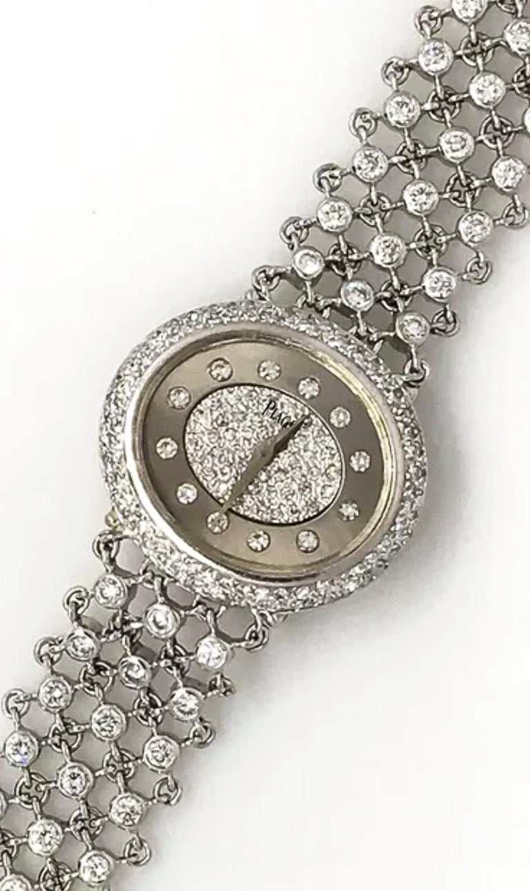 A Very Rare  1960s Piece Unique Special Order Piaget 18kt White Gold Diamond Open  work Bangle Style Bracelet watch with two tone pave diamond dial  Case Dimensions:  - 24mm x 27mm  - 190mm wrist size fits up to - can be resized as necessary as a