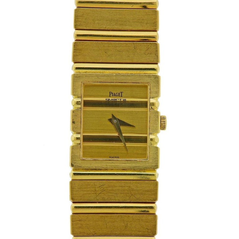 Classic 18k yellow gold Piaget Polo watch, featuring gold Piaget signed dial with gold hands. 18k gold Piaget band is 7