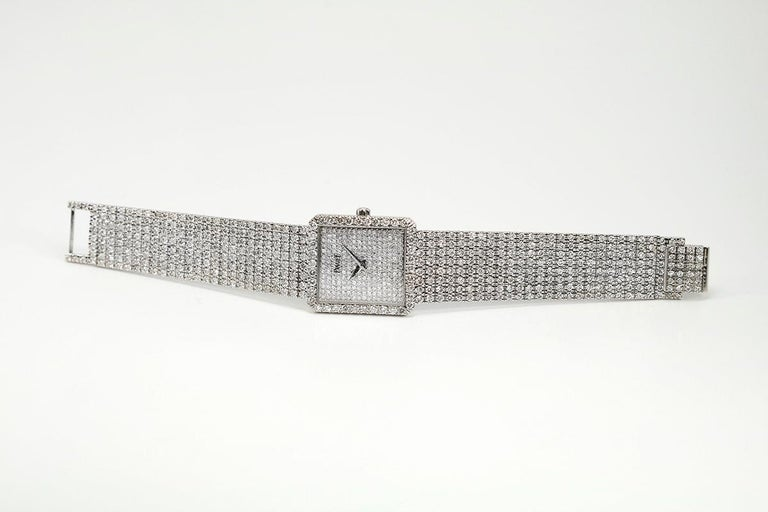 Piaget Protocole 18k white gold and diamond reference 9150 with caliber 9P2, 18-jewel manual wind movement. case measures 24.74mm wide x 27.08mm lenth, as for bracelet lenth see image on cone.