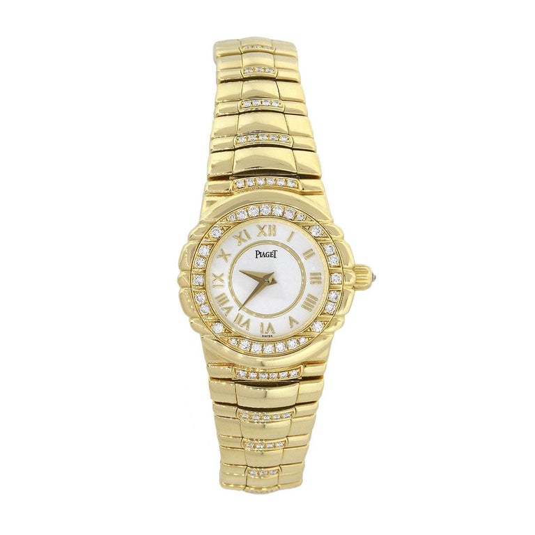 Brand: Piaget Case Material: 18k yellow gold Case Diameter: 21mm Crystal: Sapphire crystal Bezel: 18k yellow gold with diamond bezel Dial: White Dial with yellow gold roman numerals Bracelet: 18k yellow gold with diamonds Size: This will fit a 6″