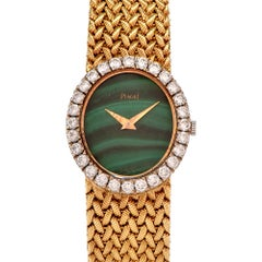 Piaget Vintage Malachite Dial Diamond Bezel 18 Karat Yellow Gold Ladies Watch