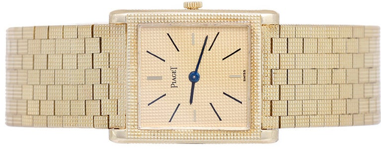 Piaget 18k yellow gold dress watch with manual-wind movement. Gilt dial with black baton markers. 18k yellow gold mesh bracelet (will fit apx. 7-in. wrist). Pre-owned with custom box.