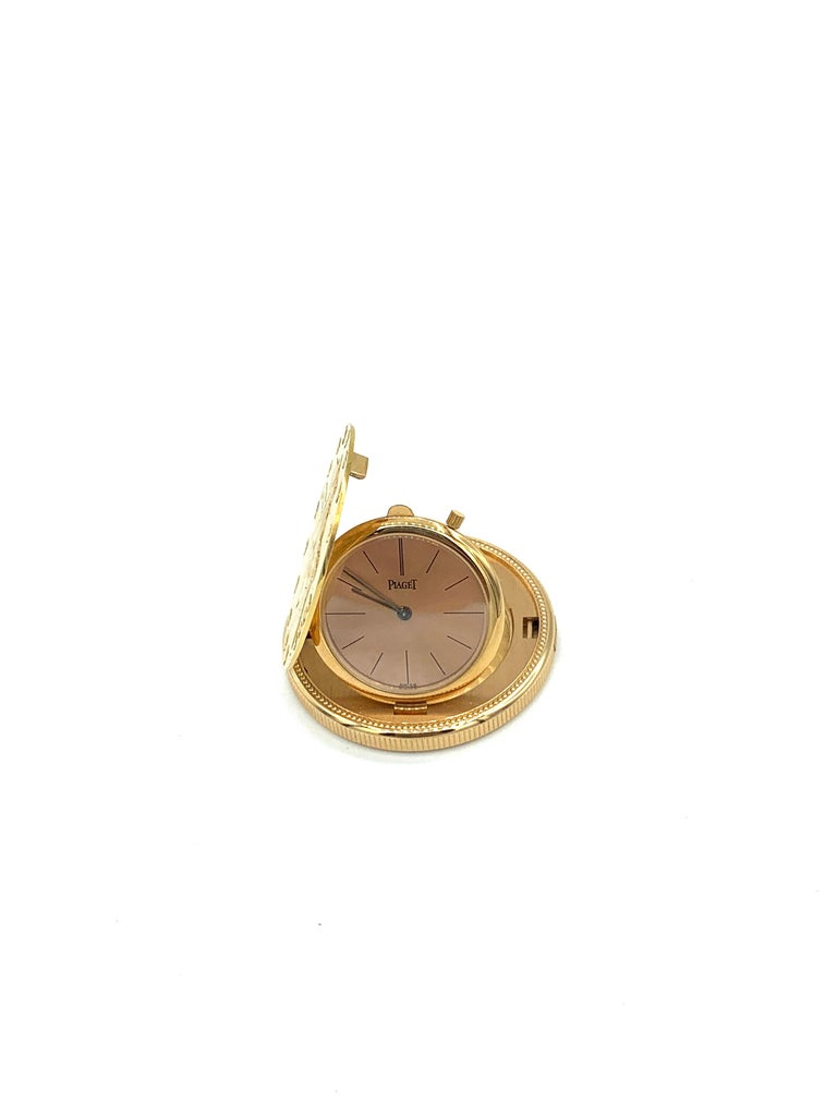 Piaget Pocket Watch. 18K Yellow Gold, 66 grams. Circa 1960. 1904 US  $20 gold piece cut in half, with a Piaget Swiss movement.   1 1/4 inches in diameter. Back of watch marked Piaget Swiss 18K 0.750, with 2 hallmarks. 2 additional hallmarks on