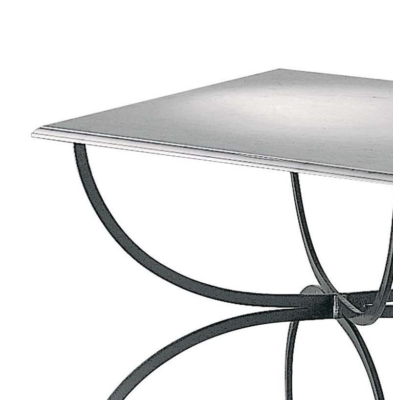 A striking addition to a patio, poolside, or terrace, this table is part of the Piazza Collection and evokes the understated elegance of Tuscan towns' piazzas. Inspired by traditional styles interpreted in a modern fashion, this table exudes