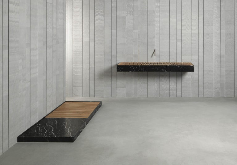 """Part of the Piano di Posa collection designed by Vittorio Longheu, Cambiaro is carved shower tray in Nero marquinea marble with footboard in natural oak wood. Dimension and material are customizable. """"Creativity hallmarked by nature"""" is the axiom"""