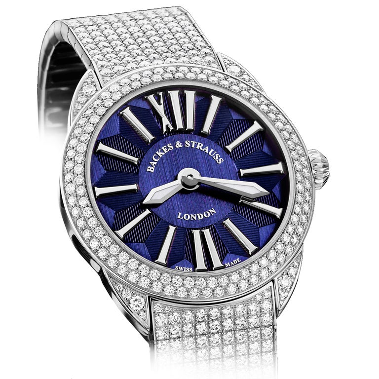 The Piccadilly Renaissance 40 is a luxury diamond watch for men and women crafted in 18kt White gold, featuring the blue dial and white gold roman numerals, mechanical movement.  The case, bracelet, buckle and crown are set with white Ideal Cut