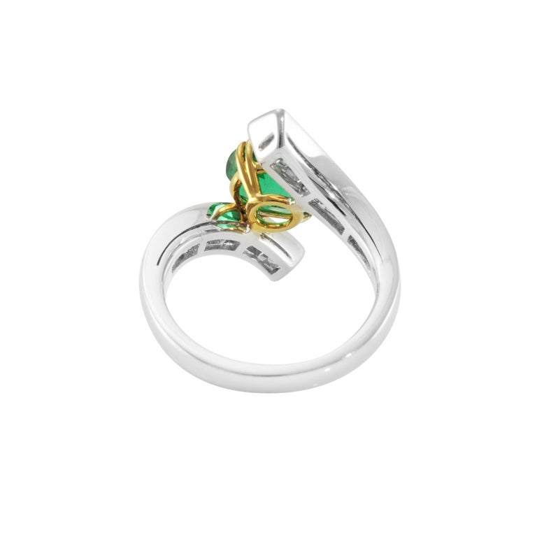 A fashion ring with an open setting made of two tapered diamond rows that hold a pretty oval emerald. Round diamonds 1.19 carats F/G color - VVS clarity Oval emerald 2.14 carats US size 6.75 Each Picchiotti item is delivered with the orginal