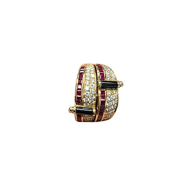Crafted by the famed Italian designer Guiseppe Picchiotti, this ring is a perfect example of his meticulous work. Set in 18 karat yellow gold this ring features two rows of square cut rubies along with two sections of pave diamonds. Two bars of
