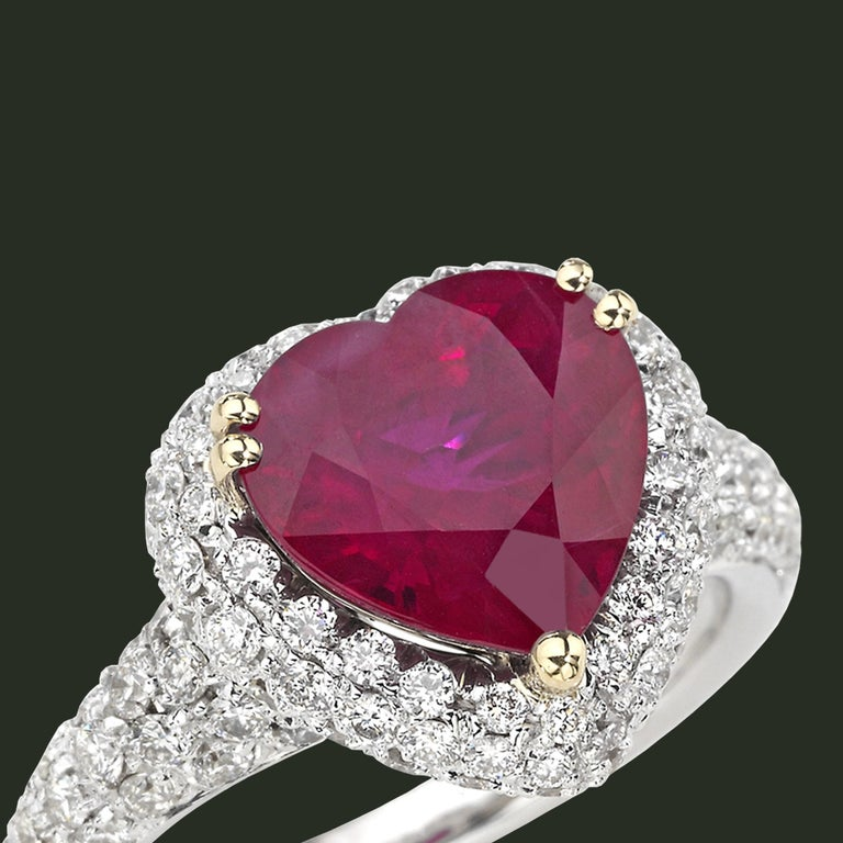 A heart-shape Ruby is the focus of this dazzling ring, that is the ultimate expression of Picchiotti's sophisticated design combined with the use of the finest raw materials and unsurpassable craftsmanship.  Round diamonds 1.55 carats F/G color -