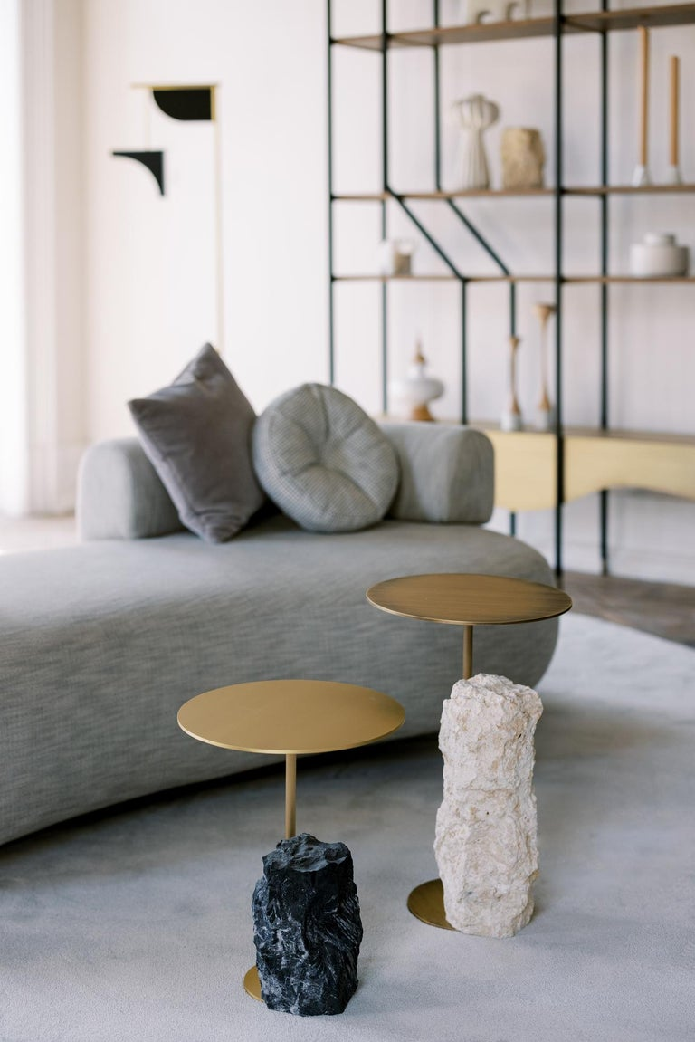 Side table in oxidised brass with matte finish. Base block in matte Grey coral stone with a split face effect.  Pico side table medium  ST055 coral color stone; matte finish ME032 oxidised brass; matte finish  Made in Portugal.