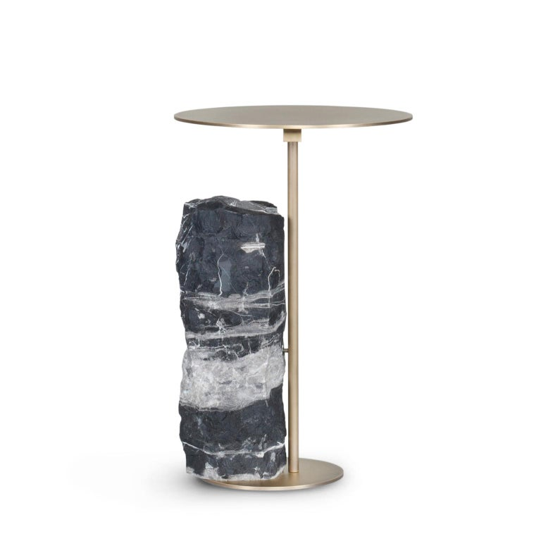 Side table in oxidized brass with matte finish. Base block in matte silver Portoro marble with a split face effect.  Pico side table medium  ST054 silver Portoro marble; matte finish ME032 oxidized brass; matte finish  Made in Portugal.