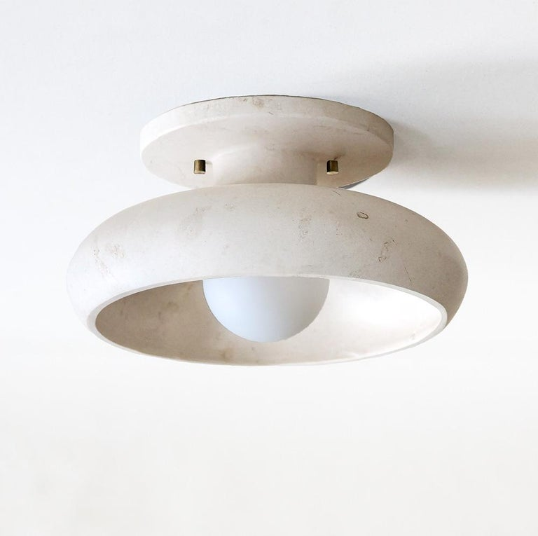 Our Piedra lighting takes its inspiration from the stone masks of the ancient civilization of Teotihuacán. Carved in the Mexican city of Tecali, which means 'stone house' in Nahuatl, the fixtures draw on the clean lines, defined angles, and