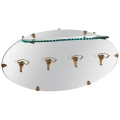 Pier Luigi Colli Golden Iron Hangers and Glass Shelf Oval Mirror, Italy, 1950