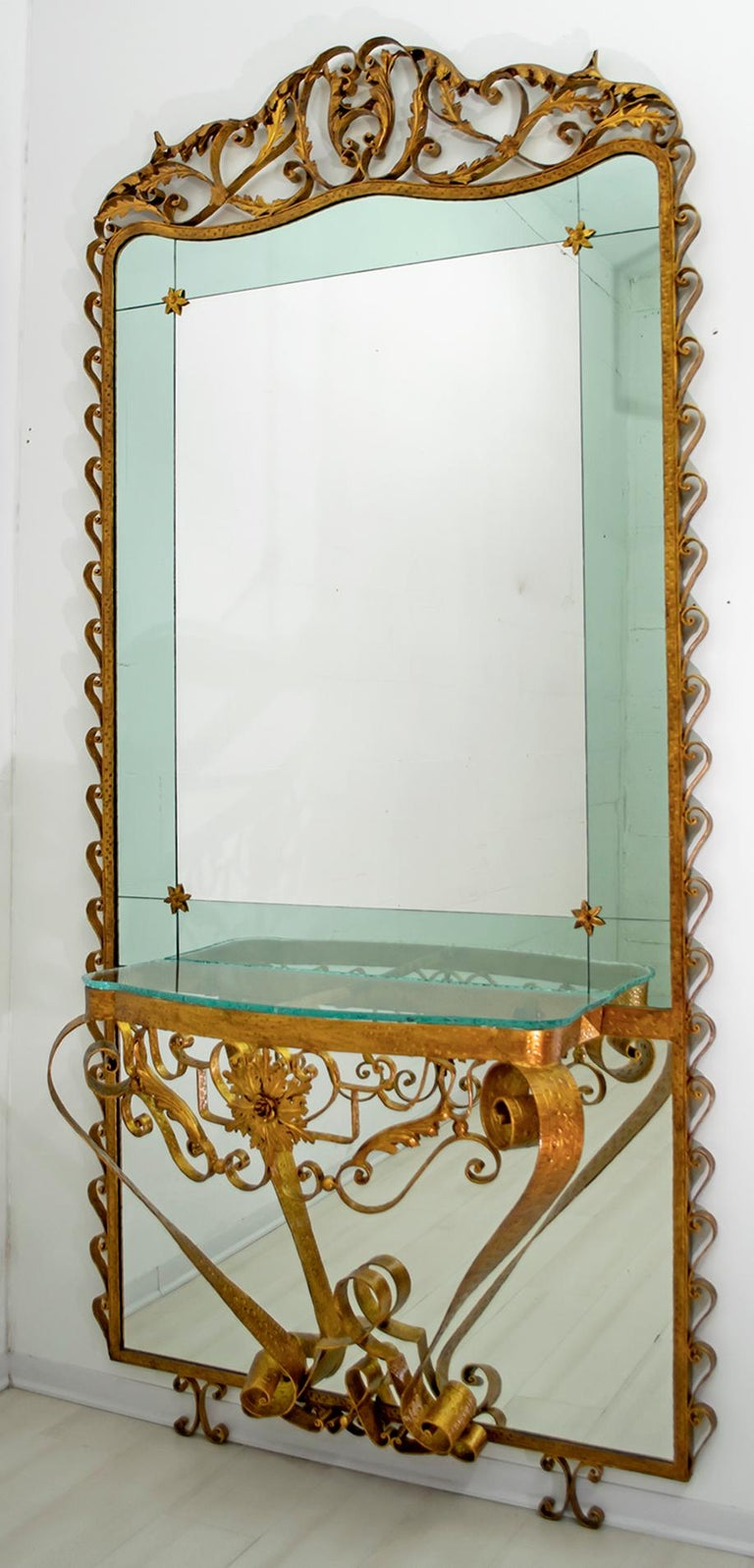 Beautiful, large and majestic entrance mirror with console, sophisticated, elegant, designed by Pier Luigi Colli, Italy, Turin 1950 The frame is in wrought iron, handcrafted, the mirror is in two colors, green and transparent, the console tabletop,
