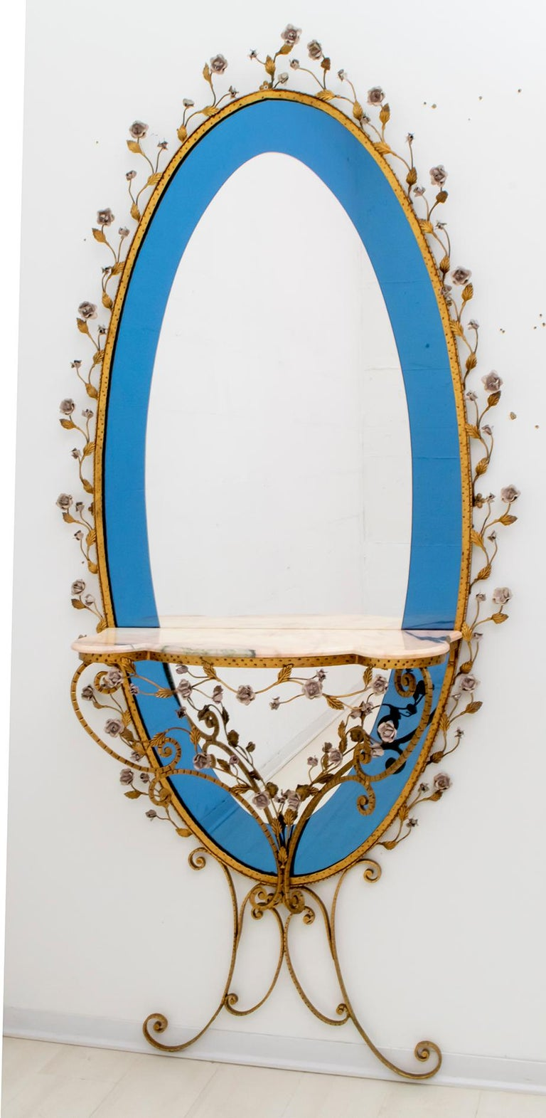 Beautiful entrance mirror with console, sophisticated, elegant, designed by Pier Luigi Colli, Italy, Turin 1950 The structure is in wrought iron, the handmade flowers in wrought iron, the mirror is in two colors, cobalt blue and transparent, the
