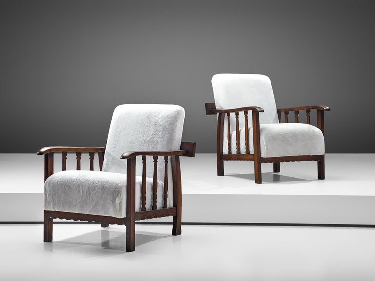 Pier Luigi Colli for Martinotti, pair of lounge chairs, darkened oak and fabric, Italy, 1940s  This beautiful set of armchairs is designed by the Italian designer Pier Luigi Colli and produced by his own company Martinotti, that was specialized in