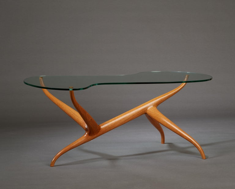 Pierluigi Giordani (1924-2011)  An exceptional, one of a kind sculptural coffee table by Pierluigi Giordani, and a masterwork of organic abstraction. A biomorphic glass top, inset with delicate brass rivets, floats cloud-like over an asymmetrical