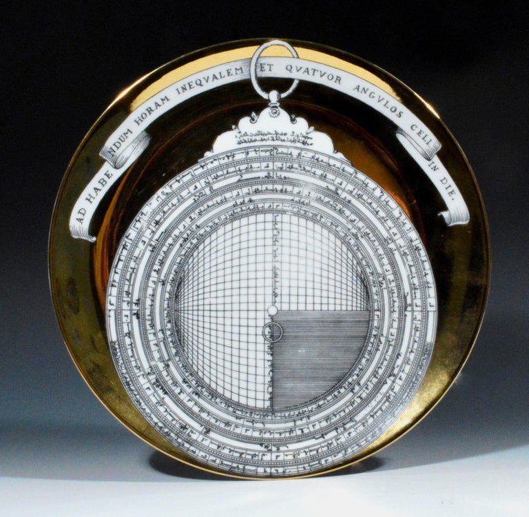 The Piero Fornasetti porcelain plate depicts an astrolabe, it is number twelve of twelve in series. A ribbon above reads