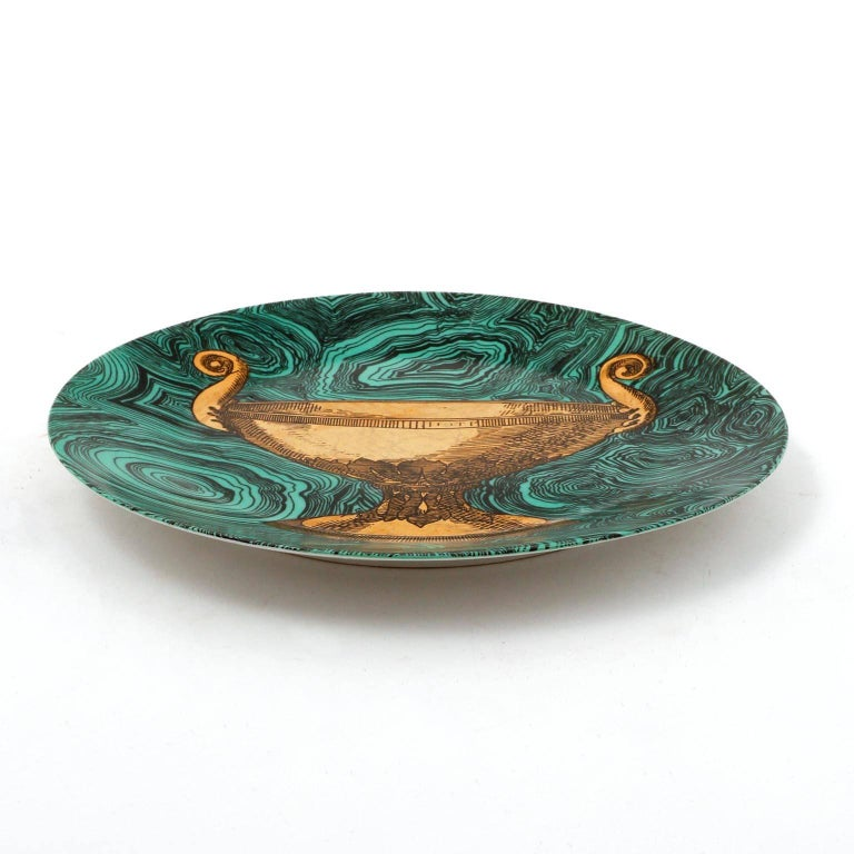 A ceramic or porcelain dish with an emerald green faux malachite ground and painted in gold by Piero Fornasetti, Italy, manufactured in midcentury in 1950s.