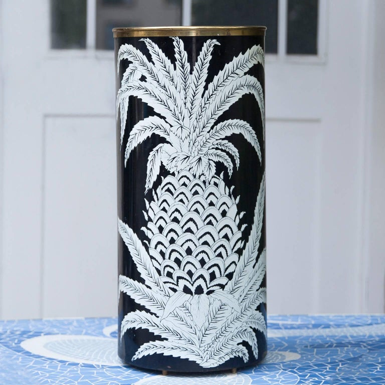 Piero Fornasetti umbrella stand with pineapple decoration, Italy, 1950s  Lithographic transfer print over masonite, brass;  Marked: Fornasetti Milano Made in Italy.